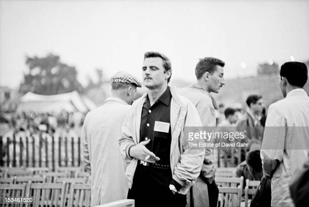 Folk singer and songwriter Cisco Houston poses for a portrait backstage in July 1960 at the Newport Folk Festival in Newport Rhode Island Cisco...