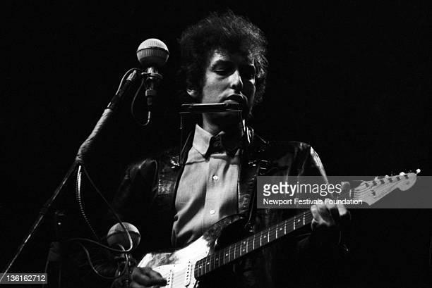 Folk singer Bob Dylan goes electric at the Newport Folk Festival on July 25 1965 in Newport Rhode Island