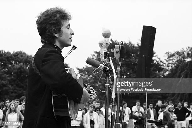 Folk singer Bob Dylan performs at the Newport Folk Festival on July 26 1964 in Newport Rhode Island