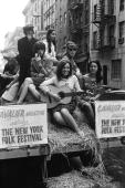 Folk singer Carolyn Hester rides on the back of a wagon promoting the New York Folk Festival in July 1965 in New York New York