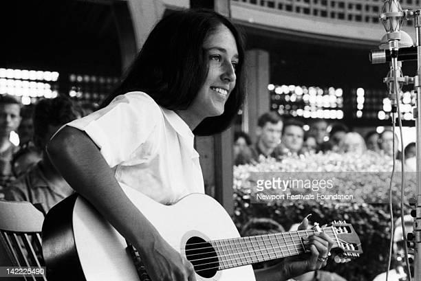 Folk singer Joan Baez performs at the Newport Folk Festival in July 1963 in Newport Rhode Island