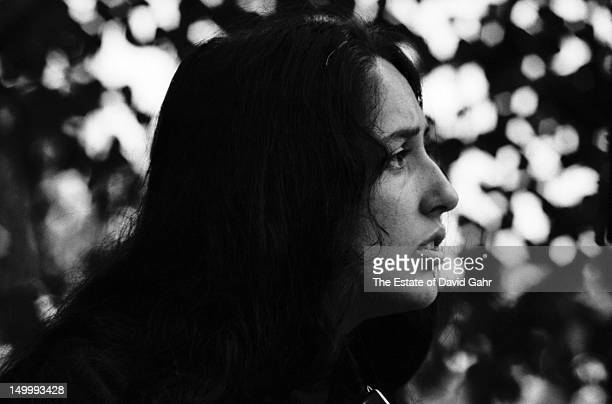 Folk singer Joan Baez performs at the Newport Folk Festival in July 1964 in Newport Rhode Island