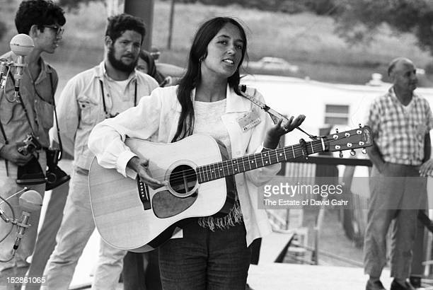 Folk singer Joan Baez performs at the Newport Folk Festival in July 1965 in Newport Rhode Island