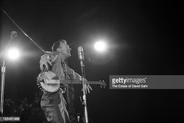 Folk singer musician songwriter and activist Pete Seeger performs at the Newport Folk Festival in July 1959 in Newport Rhode Island