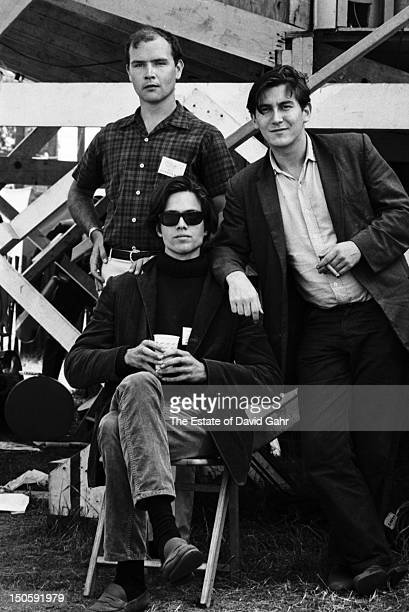 Folk singer songwriters Tom Paxton Eric Anderson and Phil Ochs pose for a portrait backstage at the Newport Folk Festival in July 1964 in Newport...