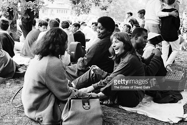 Folk singers Odetta and Judy Collins in the audience during the Newport Folk Festival in July 1964 in Newport Rhode Island