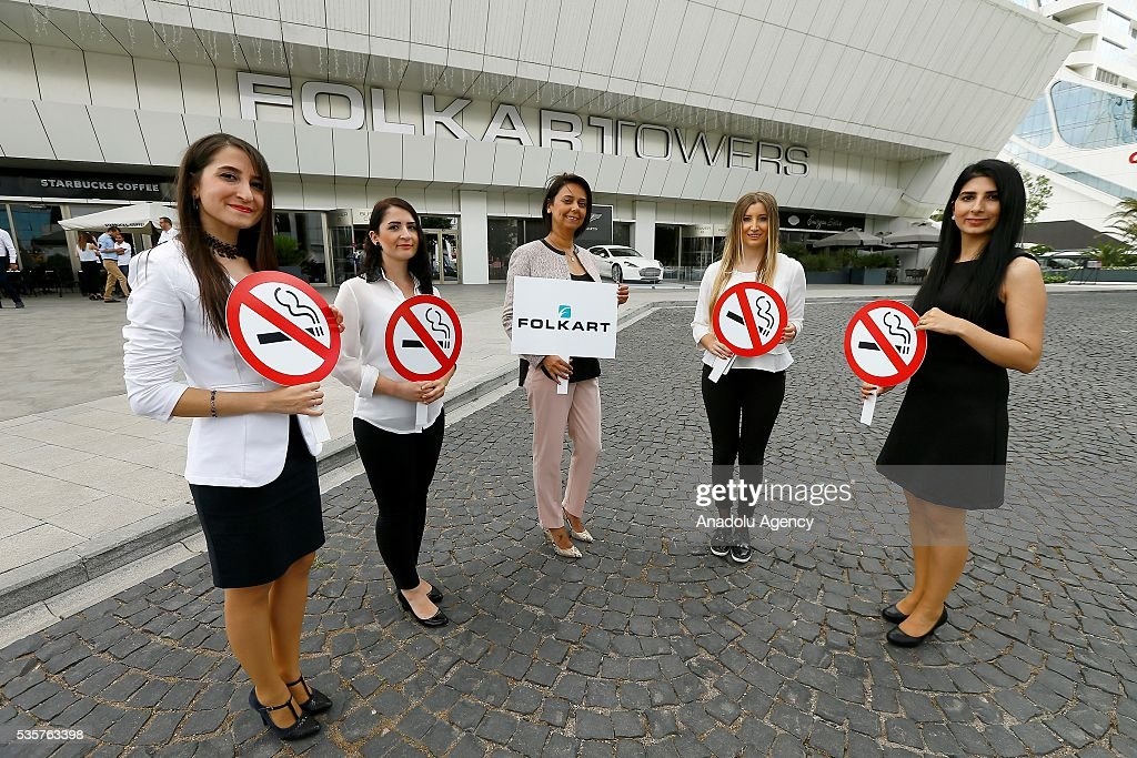 Folkart Towers workers hold banners against smoking outside the Folkart Towers ahead of 'World No Tobacco Day' in Izmir, Turkey on May 30, 2016. Smokers who work at Folkart Towers received psychological support and training by Folkart Construction to quit smoking and enter the 'World No Tobacco Day' without any smokers.