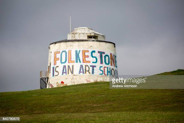 A Folkestone is an Art School banner attached to Folkestones most prominent Martello Tower on the east cliff The banner has been designed by the...