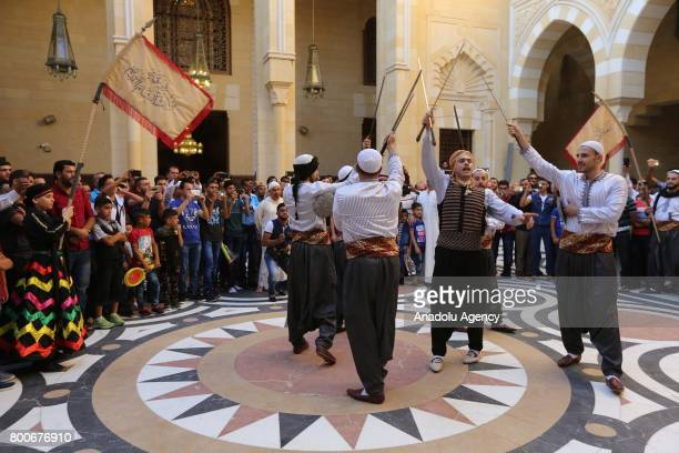 A folklore group members perform with their costumes at Al Bahaa Mosque courtyard after the Eid alFitr prayer during the Eid alFitr holiday in Sidon...