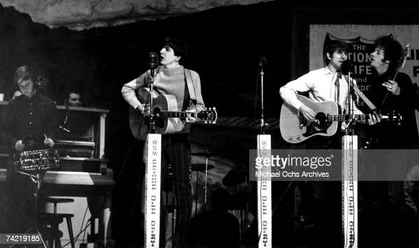 FolkRock Group 'The Byrds' perform at the Grand Ol' Opry in Nashville Tennessee circa 1968 Left to right Kevin Kelly Gram Parsons Jim McGuinn and...