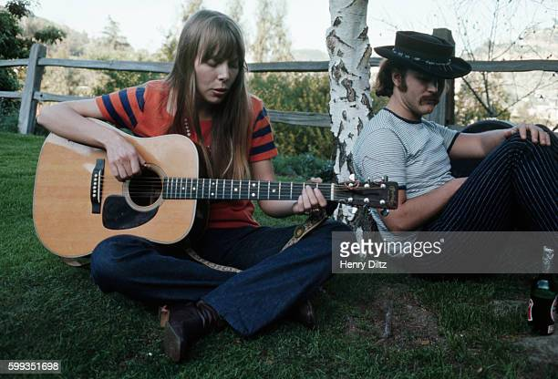 Folkrock singer David Crosby listens to Joni Mitchell playing a song Crosby became wellknown in the Byrds then moved on to Crosby Stills and Nash CSN...