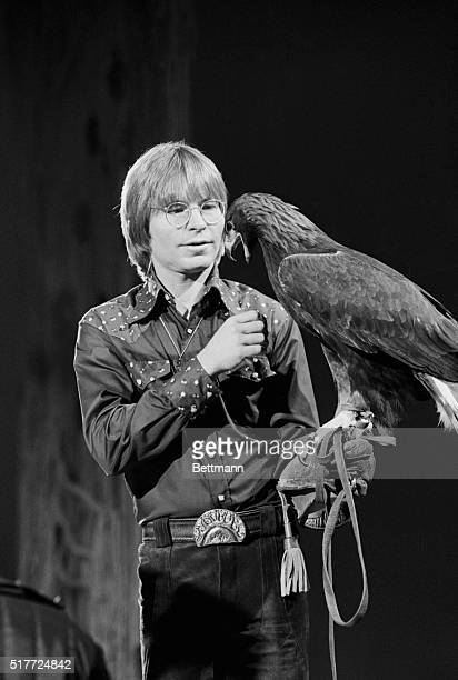 Folksinger John Denver talks to his California Golden Eagle 'Shawani' age 6 during special segment dedicated to the bird during taping of 'The John...