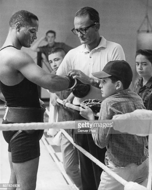 Folley Zora Getting Plenty of Help From His 'Handlers' Zora Folley world's No 3 ranked heavyweight challenger gets his gloves taped on by Manager...
