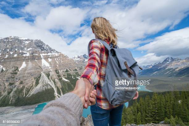 Follow me to- Young woman leading man to Peyto lake