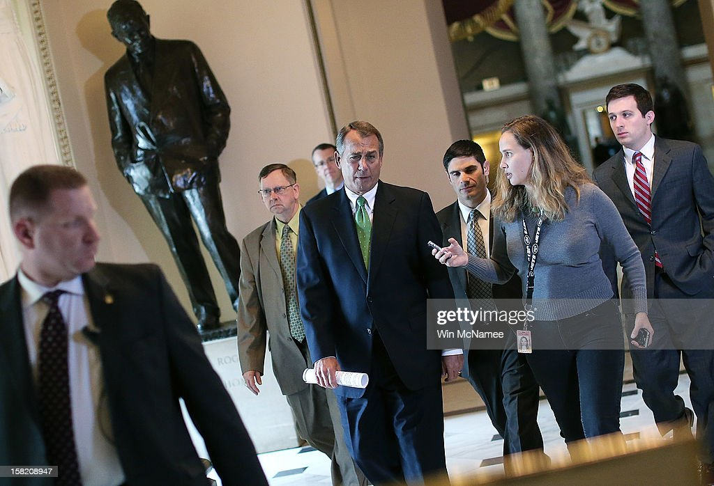 Followed by reporters, Speaker of the House John Boehner (R-OH) (4th L) walks to the House chamber to speak on the pending 'fiscal cliff' negotiations December 11, 2012 in Washington, DC. Congress and U.S. President Barack Obama's White House remain locked in a stalemate over the negotiations seeking a settlement to the fiscal crisis.