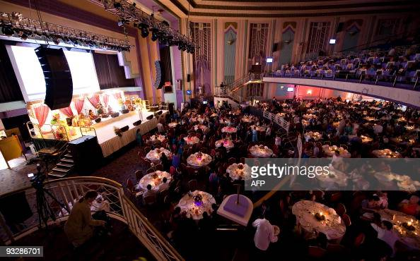 Followers of Hare Krishna celebrate the fortieth anniversary of the establishment of their first temple in London during a dinner at the Troxy...