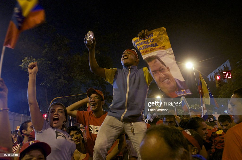 Followers of Hugo Chavez celebrate his victory in the presidential elections in Venezuela on October 07, 2012 in Caracas, Venezuela. Chavez won with 54.42% (7,444,082 votes) while Henrique Capriles, runner-up, obtained 44.97% (6,150,544 votes). With these results the government will rule the next presidential term from 2013 to 2019, which mean Chavez will be 19 years in power.