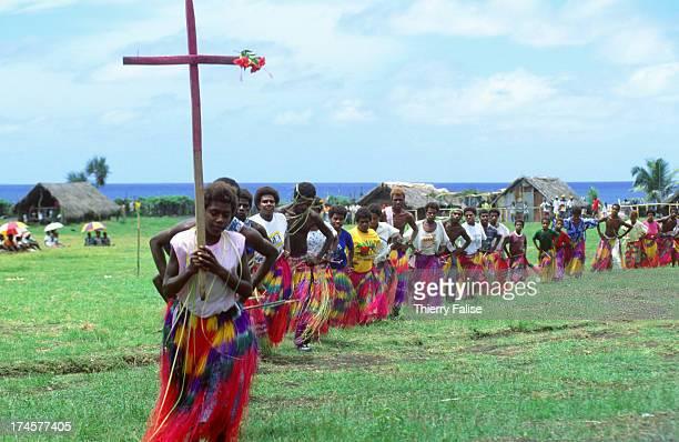 Followers of John Frum walk in a cortege behind a cross Every February 15th followers of John Frum a cargo cult leader organize a big celebration in...