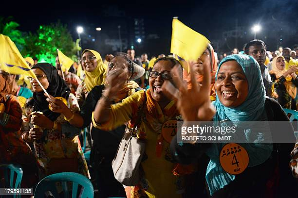 Followers of Presidential candidate Mohamed Nasheed exult during a political rally in Male the capital of Maldives on September 5 2013 two days...