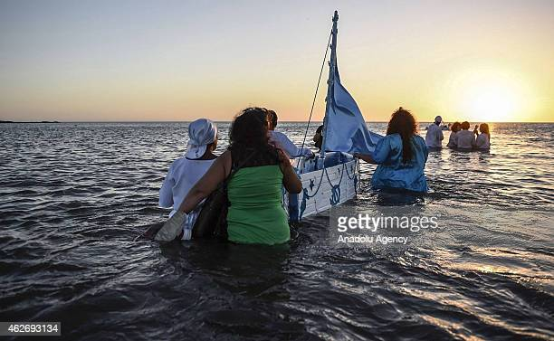 Followers of the AfroAmerican religion Candomble take part in a ritual for Iemanja the African goddess of the sea in Montevideo on February 2 2015...