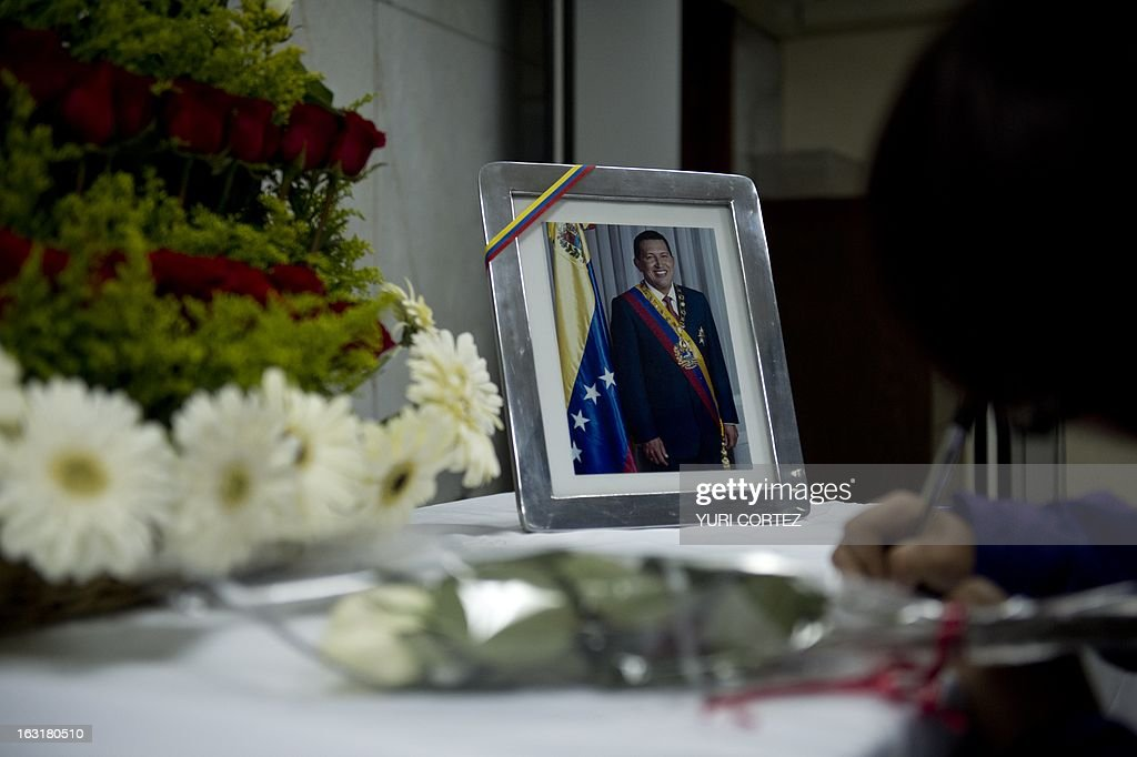 Followers of the late Venezuelan President Hugo Chavez sign the book of condolences at the Venezuelan Embassy in Mexico City on March 5, 2013. Chavez lost his battle with cancer on March 5, 2013, his death silencing the leading voice of the Latin American left and plunging his oil-rich nation into an uncertain future. AFP PHOTO / Yuri CORTEZ