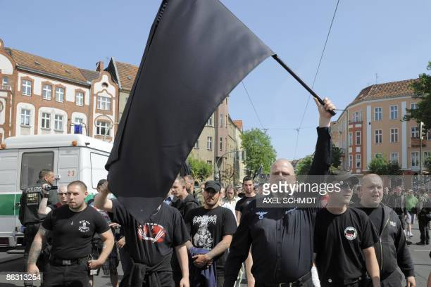 Followers of the neoNazi party NPD wave a black flag during May Day demonstrations in Berlin's Koepenick district on May 1 where riots were carried...