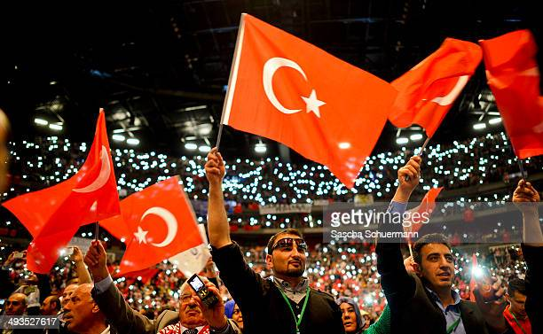 Followers of Turkish Prime Minister Recep Tayyip Erdogan attend an event to mark the 10th anniversary of the UETD the Union of European Turkish...