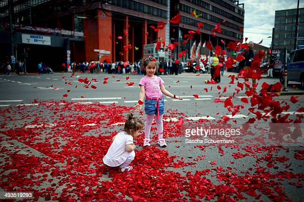 Followers of Turkish Prime Minister Recep Tayyip Erdogan throw roses for him at an event to mark the 10th anniversary of the UETD the Union of...
