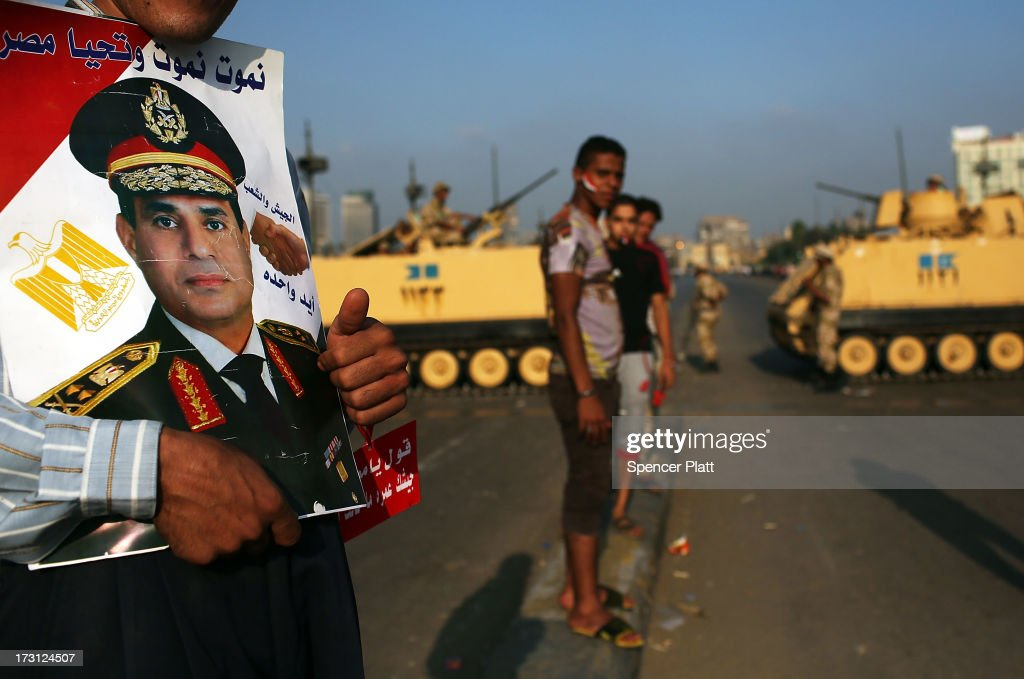 Following a day of massive rallies against the ousted Egyptian President and an early morning shooting of pro Mohamed Morsi supporters outside a Presidential Guard barracks, members of the Egyptian military and their supporters guard a bridge near Tahrir Square on July 8, 2013 in Cairo, Egypt. Egypt continues to be in a state of political paralysis with scores of people having been killed and many injured in recent days as the Egyptian military attempts to restore order across the country following their ousting of Morsi.