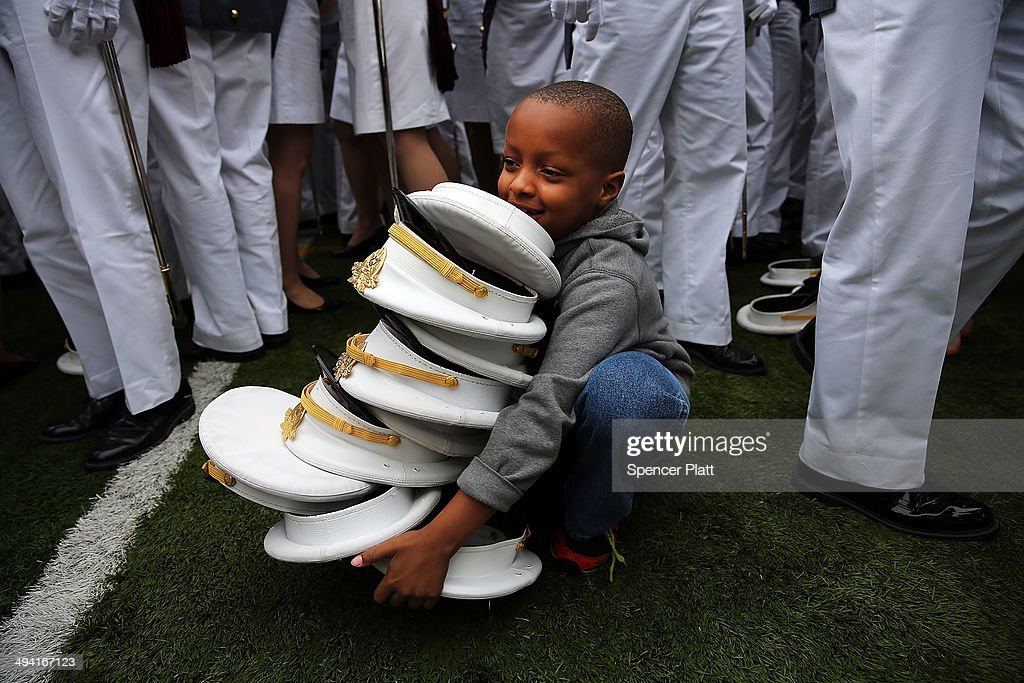 Following a West Point tradition, Alan Jones, age 7, gathers caps after graduating cadets threw them in the air at the conclusion of the graduation ceremony at the U.S. Military Academy at West Point on May 28, 2014 in West Point, New York. U.S. President Barack Obama gave the commencement address at the graduation ceremony. In a highly anticipated speech on foreign policy, the President provided details on his plans for winding down America's military commitment in Afghanistan and on future military threats to the United States. Over 1,000 cadets were expected to graduate from the class of 2014 and will be commissioned as second lieutenants in the U.S. Army.