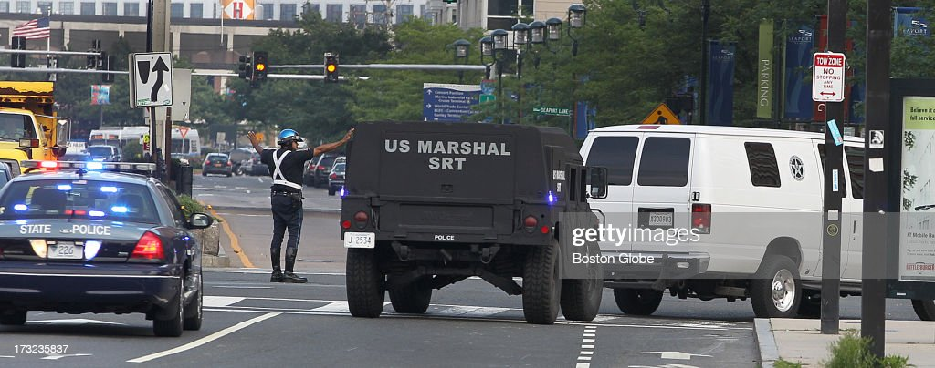 Following his arraignment, the motorcade carrying Boston Marathon bombings suspect Dzhokhar Tsarnaev heads onto B Street from Seaport Boulevard after leaving the John Joseph Moakley United States Courthouse, on Wednesday, July 10, 2013.