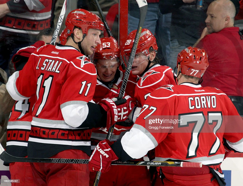 Following his second-period goal, Jeff Skinner #53 of the Carolina Hurricanes is surrounded by teammates Bobby Sanguinetti #24, Jordan Staal #11, Alexander Semin #28 and Joe Corvo #77 during their NHL game against the Boston Bruins on January 28, 2013 at PNC Arena in Raleigh North Carolina.
