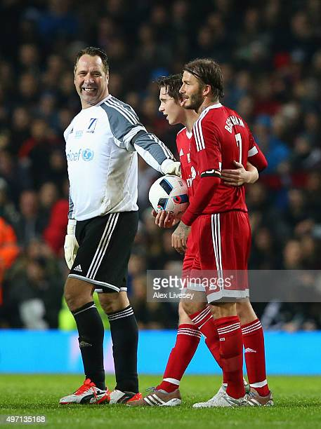 Following the final whistle David Beckham of Great Britain and Ireland his son Brooklyn Beckham and David Seaman walk off the pitch during the David...