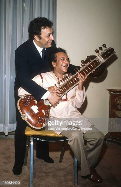 Following the first performance of his 'Concerto No 2 for Sitar and Orchestra' Indian musician Ravi Shankar poses with conductor Zubin Mehta of the...