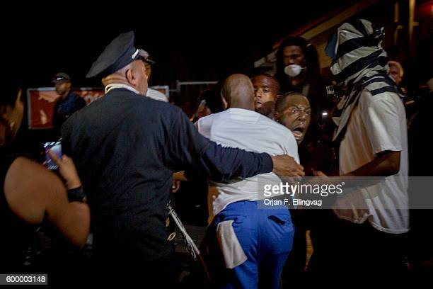 Following the killing of unarmed Michael Brown demonstrators try to calm down a protester seething with anger and frustration The mans anger is...