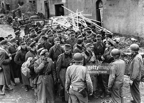 Following the orders of Colonel Gerhard Wilck a group of Nazi officers surrendering to US troops on October 10 1944 in Aachen Germany