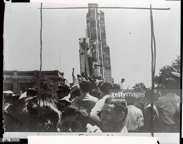 Following the overthrow of Premier Mossadegh crowds favoring the return of Shah Mohammed Reza Pahlevi demonstrated their support by hoisting up his...