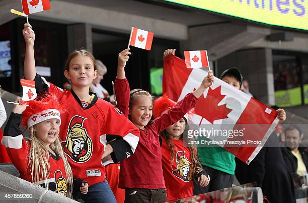 Following the tragic events earlier this week fans showed their Canadian pride during the Ottawa Senators and New Jersey Devils NHL game at Canadian...
