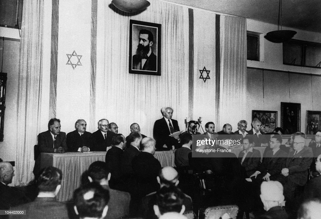 Following the United Nations vote dividing Palestine David BEN GOURION declared Israel a state in TelAviv Above him is a portrait of Theodore HERZL...