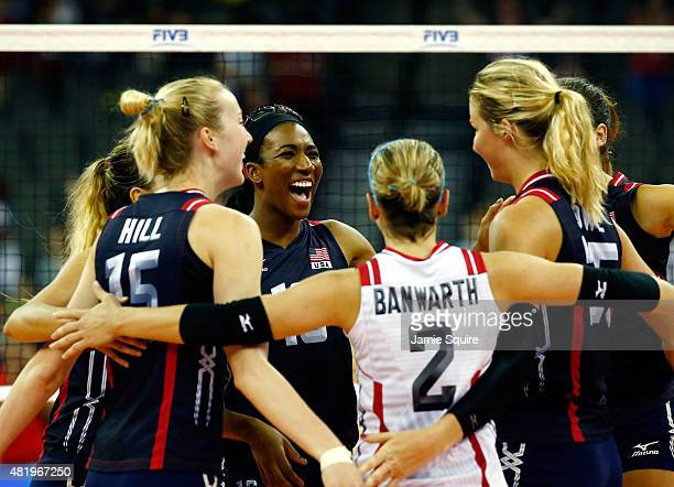 Foluke Akinradewo of the USA and teammates celebrate after winning set point of the second set during the final round match against Brazil on day 4...