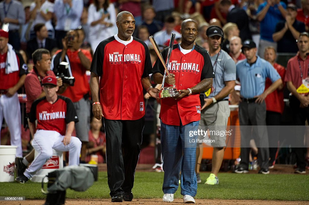 Fomer Cincinnati Reds players Dave Parker and Eric Davis bring out the Home Run Derby Trophy during the Gillette Home Run Derby presented by Head...