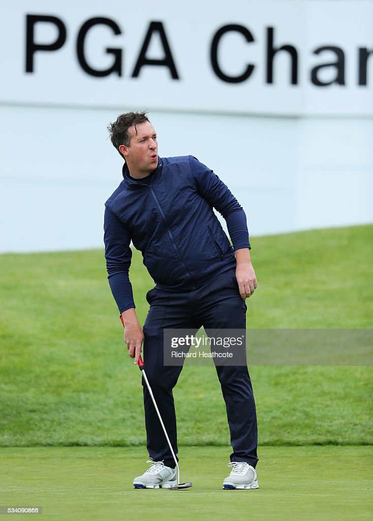 Fomer footballer <a gi-track='captionPersonalityLinkClicked' href=/galleries/search?phrase=Robbie+Fowler&family=editorial&specificpeople=206154 ng-click='$event.stopPropagation()'>Robbie Fowler</a> reacts during the Pro-Am prior to the BMW PGA Championship at Wentworth on May 25, 2016 in Virginia Water, England.