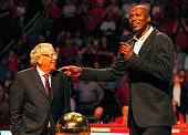 Fomer Houston Rocket Hakeem Olajuwon speaks to the crowd alongside team owner Leslie Alexander as the team honors the 20th anniversary of backtoback...