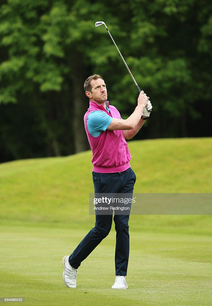 Fomer rugby player Will Greenwood hits his 2nd shot on the 18th hole during the Pro-Am prior to the BMW PGA Championship at Wentworth on May 25, 2016 in Virginia Water, England.