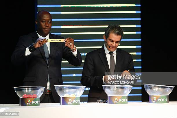 Fomer Senegalese football player Khalilou Fadiga shows a piece of paper bearing the name of Ouganda next to Confederation of African Football...