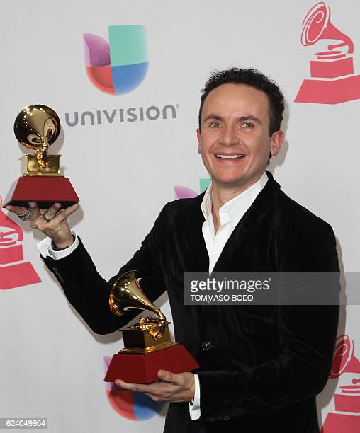 Fonseca poses with his awards for Best Tropical Song' and 'Best Cumbia/Vallenato Album' in the press room during the 17th Annual Latin Grammy Awards...