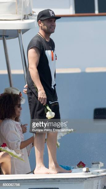 Fonsi Nieto scatters Angel Nieto's ashes into the Mediterranean sea on August 6 2017 in Ibiza Spain