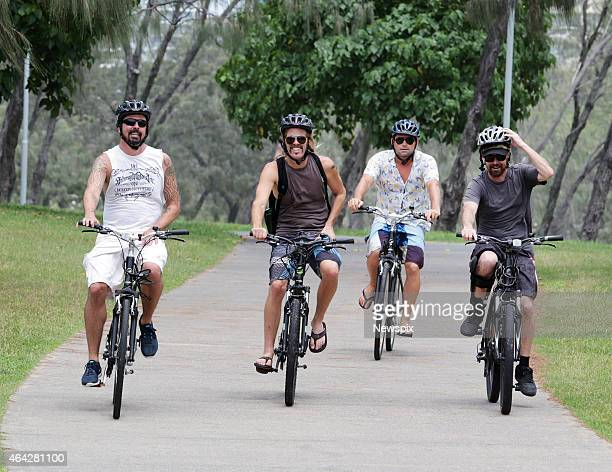 'Foo Fighters' frontman Dave Grohl and drummer Taylor Hawkins and some friends bike ride around the Gold Coast on February 23 2015 ahead of their...