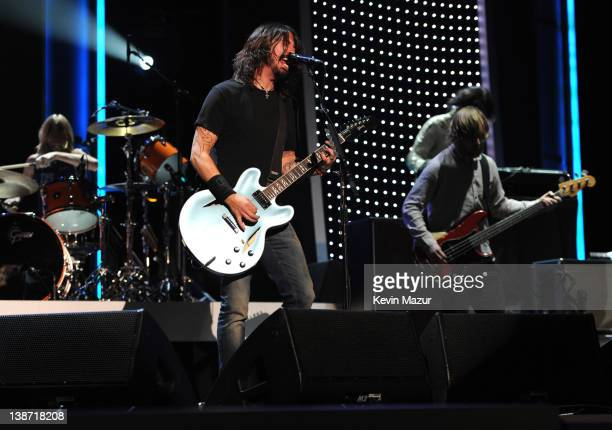 Foo Fighters perform on stage at The 2012 MusiCares Person Of The Year Gala Honoring Paul McCartney at Los Angeles Convention Center on February 10...