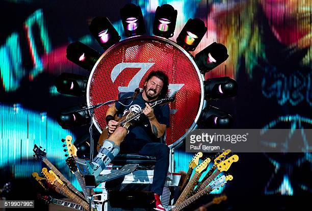 Foo Fighters singer and guitarist Dave Grohl performs on stage in a special throne due to his broken leg at Ziggodome Amsterdam Netherlands 05...